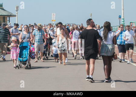 Brighton  Sussex UK. 7th May 2018. Large crowds of Beachgoers and sun worshippers  descend on Brighton beach to enjoy the hot May bank holiday sunshine with record temperatures forecast for this time of the year Credit: amer ghazzal/Alamy Live News Credit: amer ghazzal/Alamy Live News - Stock Photo
