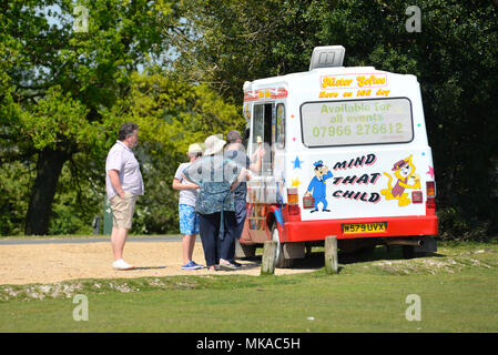 People queuing at an ice cream van in on a sunny day during a summer heatwave in the south of England national park, New Forest, Hampshire, England, UK - Stock Photo