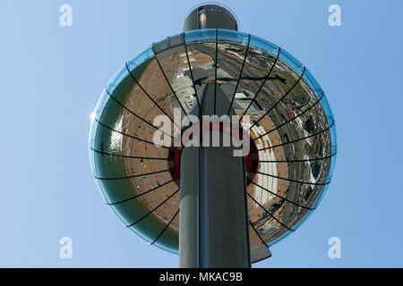 Brighton & Hove Beach, East Sussex, UK. 7th May 2018. Brighton & Hove Beach Bank Holiday as tempretures reach record levels for a early May holiday weather. This image captured the reflection from underneath the I360 Tower.City of Brighton & Hove Beach, East Sussex, UK. 7th May 2018 Credit: David Smith/Alamy Live News - Stock Photo
