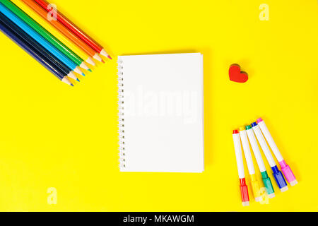 Top view concept of education, first of September back to school with pencils, blank notepad yellow background - Stock Photo