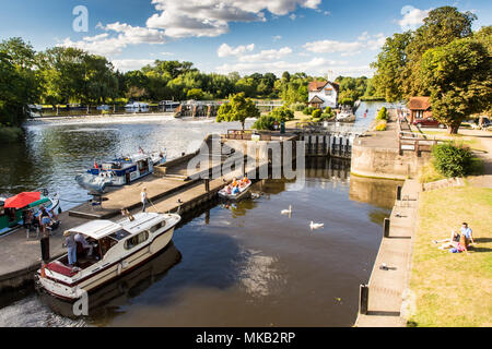 Reading, England, UK - August 29, 2016: The weir and lock on the River Thames at Goring in Oxfordshire. - Stock Photo