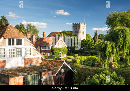 Reading, England, UK - August 29, 2016: Traditional cottages and parish church beside the River Thames in the village of Goring, Berkshire. - Stock Photo