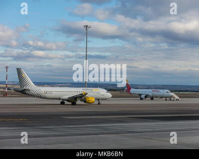 A plane prepares to take off on the runway of Terminal T4 the Adolfo Suarez Madrid Barajas Airport. Barajas is the main international airport in Madri - Stock Photo