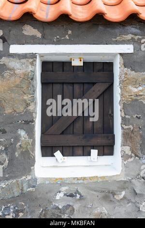 Wooden window shutter on a cottage in the fishing village of Crovie, Aberdeenshire, Scotland,UK - Stock Photo