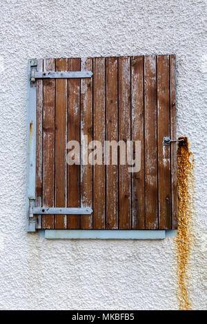 Fading wooden window shutter on a cottage in the fishing village of Crovie, Aberdeenshire, Scotland,UK - Stock Photo