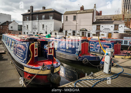 Colourful narrow canal boats on Gas Street Basin - Stock Photo