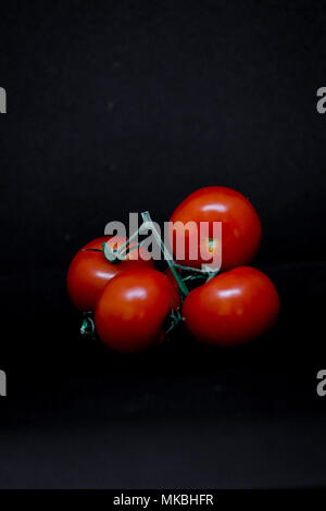 Fresh tomatoes on black background. Food concepts. Illustrative - Stock Photo