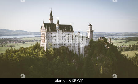 Beautiful view of world-famous Neuschwanstein Castle, the 19th century Romanesque Revival palace built for King Ludwig II, in evening light at sunset  - Stock Photo