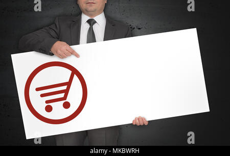 Cart poster is held by businessman. - Stock Photo