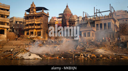 Hindus believe that being cremated here on the banks of the Ganges ends the cycle of life and death. - Stock Photo