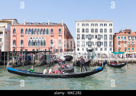 Asian tourists on Basino San Marco (St Marks Basin)  enjoying a gondola ride  in front of the Danieli Hotel, Castello, Venice, Veneto, Italy, - Stock Photo
