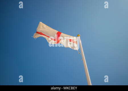 St George's flag on a clear sunny day - Stock Photo