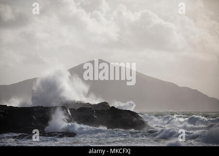 Waves breaking on the coastline of Achill Island County Mayo Ireland with Clare Island in the background. - Stock Photo