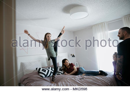 Family relaxing, playing on bed - Stock Photo