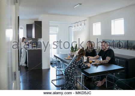Family eating breakfast at dining table - Stock Photo