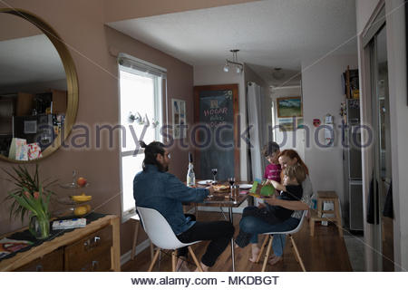 Family eating dinner at dining table - Stock Photo