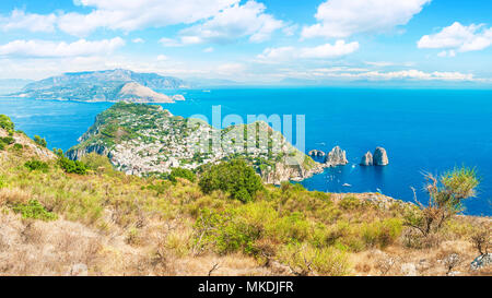 panoramic view of Capri city, sea and mountains from top of monte solaro mountain on sunny summer day, Capri, Italy - Stock Photo