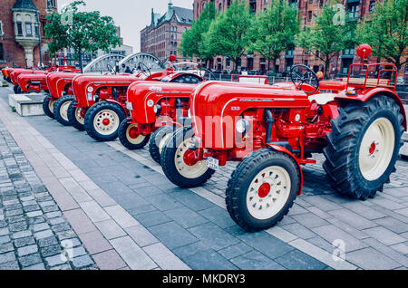 Porsche Diesel Tractors lined up in a display in the HafenCity port area of Hamburg - Stock Photo
