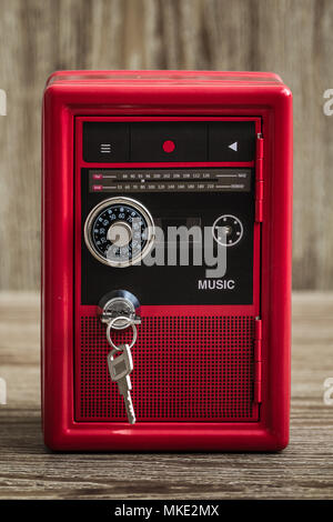 Metal lock toy box bank safe with cassette player design - Stock Photo