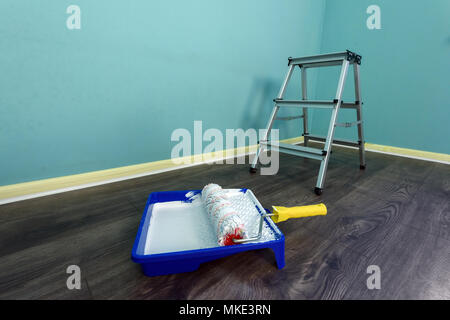 Painting tools on wall background - Stock Photo