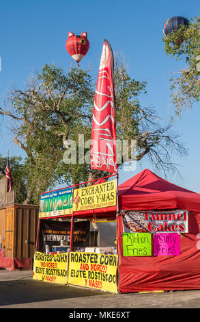 Elote and hot air balloons at Cinco de Mayo celebration in New Mexico, USA. - Stock Photo