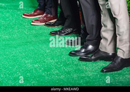 male models with brogues standing in a fashion show - Stock Photo