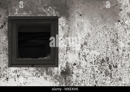 Old aged rusted grey black white shack hut wall paint, broken window glass wooden frame, weathered grungy rusty steel dirty gray painted metallic - Stock Photo
