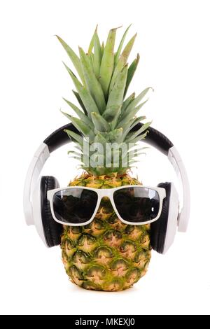 Hipster pineapple with trendy sunglasses and headphones isolated on a white background - Stock Photo