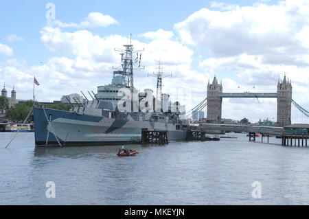 HMS Belfast is a Town-class light cruiser that was built for the Royal Navy. It is now permanently moored as a museum ship on the River Thames in Lond - Stock Photo