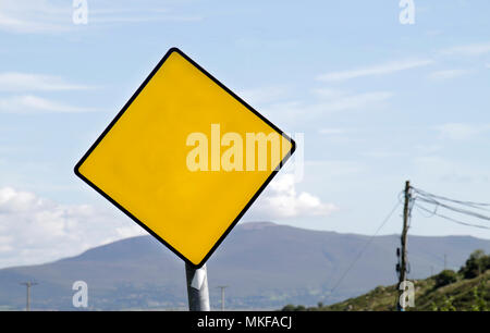 Yellow road warning sign with copy space - Stock Photo