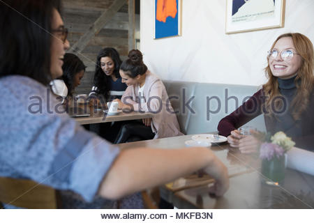 Smiling, happy couple talking in cafe - Stock Photo