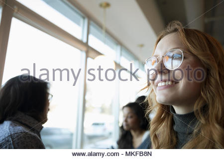 Portrait smiling, confident, ambitious young woman looking away - Stock Photo