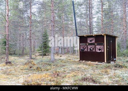 Photography hide for Brown bear (Ursus arctos), Kajaani, Kuhmo area, Finland - Stock Photo