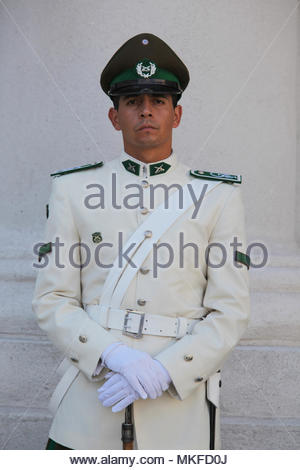 Santiago, Chile - A uniformed guard outside The Palacio de la Moneda in Santiago. - Stock Photo