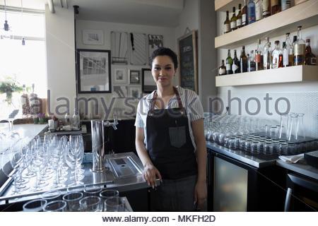 Portrait confident female small business owner working in bar - Stock Photo