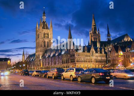 The magnificent Cloth Hall  in Ypres, Belgium illuminated at night - Stock Photo