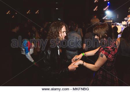 Millennial couple dancing in nightclub - Stock Photo