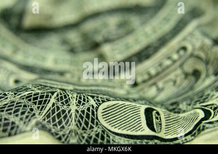 The O of the ONE is the focus of this close up of the reverse of the US dollar bill. - Stock Photo