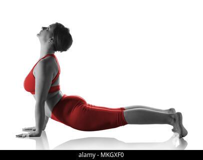 Woman doing cobra pose on white - Stock Photo