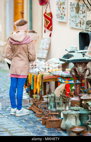 Little girls in a local market in the Old City in Baku - Stock Photo