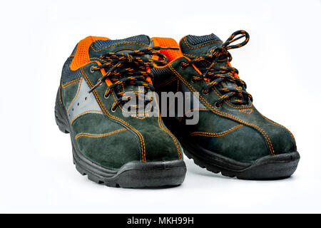 Pair of black safety leather shoes isolated on white background with copy space. Work shoes for men in factory or industry to protect foot from accide - Stock Photo
