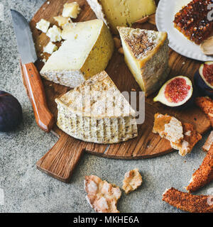 Cheese assortment, figs, honey, fresh bread and nuts, square crop - Stock Photo