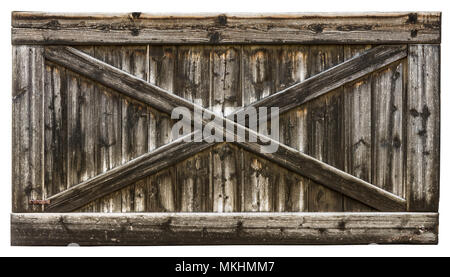 Old rural wooden gate in a frame made of battens. Vintage striped texture from the barn door with a cross from laths. Isolated on white background. - Stock Photo