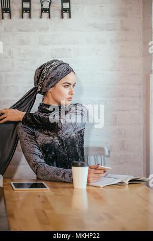 muslim hijab women holding smartphonephone. texting on phone - Stock Photo