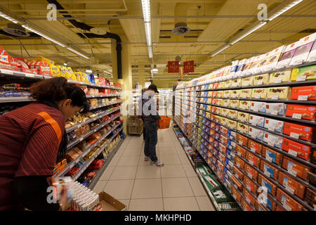 Shelves filled with chocolate bars at a Migros supermarket aisle in Zug, Switzerland, Europe - Stock Photo