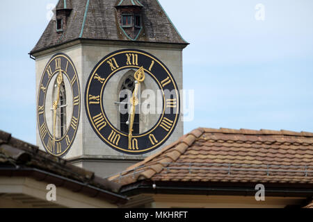 Clock tower of the St. Peter evangelical church in Zurich, Switzerland, Europe - Stock Photo