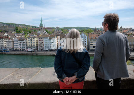 Two people looking at the skyline of Zurich from the Lindenhof hill, Switzerland, Europe - Stock Photo