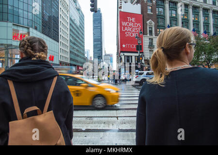 NEW YORK - OCTOBER 29 2017: Two girls are about to cross a Manhattan intersection, New York City, USA. - Stock Photo
