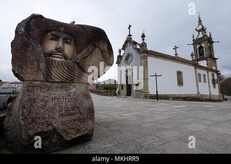 Sculpture honoring the pilgrims of the St. James way next to the Igreja de Santo António da Torre Velha catholic church in Ponte de Lima, Portugal - Stock Photo