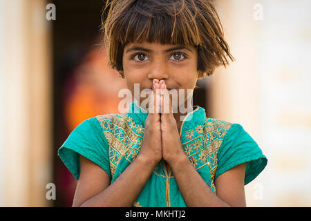 RAJASTHAN - INDIA - 20 December 2017. Portrait of a beautiful young girl with her folded hands. Picture taken from a rural village in Rajasthan. India - Stock Photo